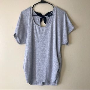 gray tee with a black bow on the back. 🎀